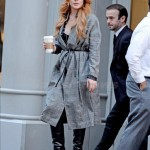 Lindsay Lohan steps out in a grey plaid jacket in SoHo, NYC